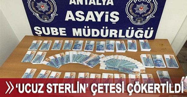 Antalya'da  'Ucuz Sterlin' çetesi çökertildi