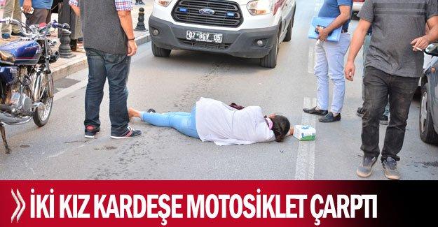İki kız kardeşe motosiklet çarptı