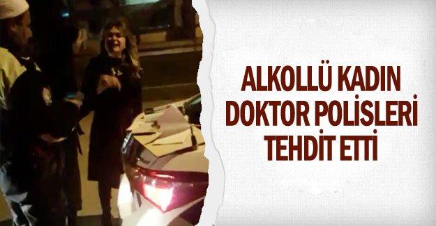 Alkollü kadın doktor polisleri tehdit etti