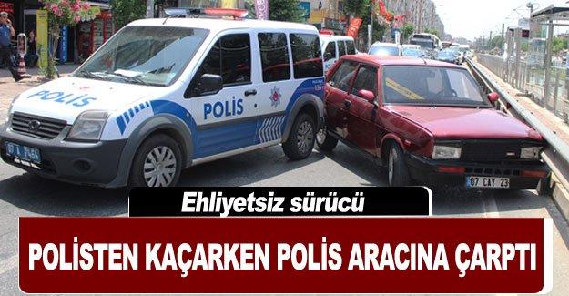 Ehliyetsiz sürücü polisten kaçarken polis aracına çarptı