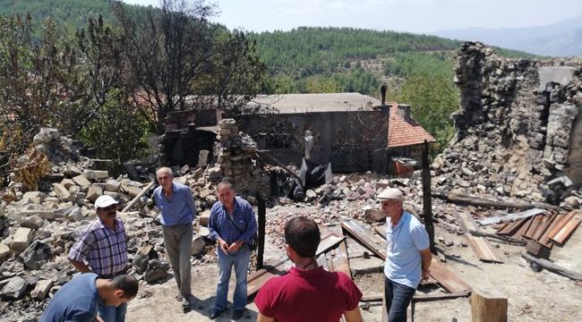 Evleri yanan 3 aileye destek