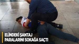 Polisten kaçabilmek için elindeki şantaj paralarını sokağa saçtı