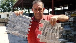 Antalya'da işlediği taşları dünyaya satıyor