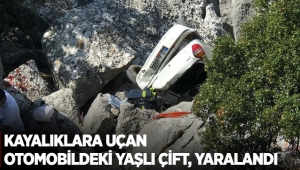 Kayalıklara uçan otomobildeki yaşlı çift, yaralandı