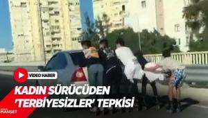 Otomobile tutunan 5 patenciyi gören kadın sürücüden 'Terbiyesizler' tepkisi
