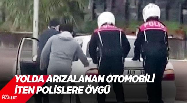 Yolda arızalanan otomobili iten polislere övgü