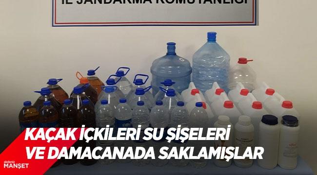Kaçak içkileri plastik su şişeleri ve damacanada saklamışlar